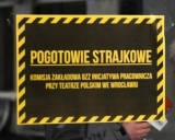 "The sign says: ""Strike alert. Workplace Committee of the Workers' Initiative Union at the Polski Theatre in Wrocław"""